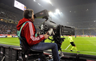 Answer CAMERAMAN, HEADPHONES, FIELD, BANNER, CABLE, REFEREE, THUMB, SOCCER PLAYER