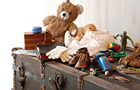 Answer TEDDY BEAR, TRUNK, BABY SHOES, SOLDIER, GLOVES, YOYO, TOY DOLL, MARBLES